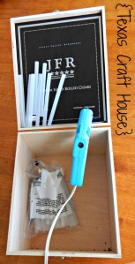 {Texas Craft House} Repurpose old cigar box into a glue gun storage and stand