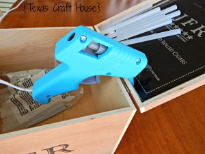 {Texas Craft House} Repurpose an old cigar box into a glue gun stand and storage